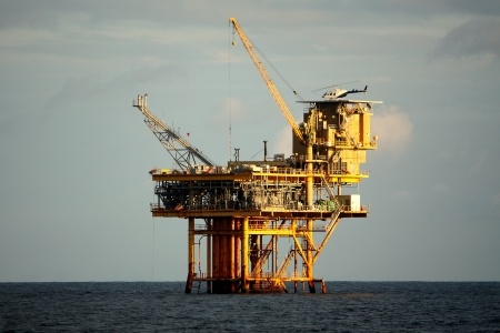 An offshore oil production platform with a helicopter on deck