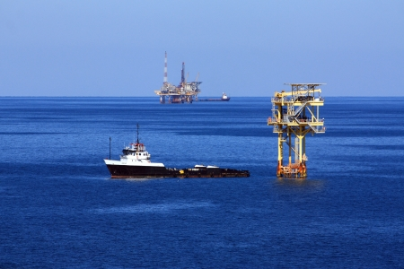 An oilfield supply boat moored to a platform in the Gulf of Mexico
