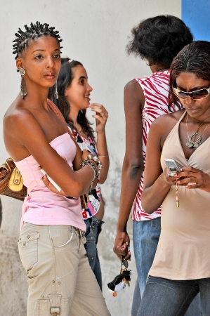HAVANA, CUBA, MAY 6, 2009  Cuban women hanging out in the street in Havana, Cuba, on May 7th, 2009