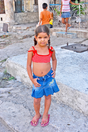 cuba girl: HAVANA, CUBA, MAY 11, 2009  A small girl in the age of five standing in a yard made of concrete in Havana, Cuba, on May 11th, 2009   Editorial