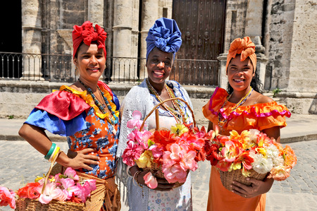 HAVANA, CUBA, MAY 6, 2009  Three Cuban women in traditional dresses in Havana, Cuba, on May 6th, 2009