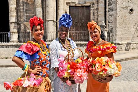 HAVANA, CUBA, MAY 6, 2009  Three Cuban women in traditional dresses in Havana, Cuba, on May 6th, 2009