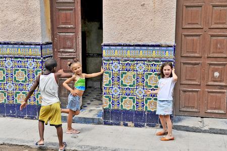 between 5 and 10 years: HAVANA, CUBA, OCTOBER 20, 2009  Young children between 5 and 10 years posing in Havana, Cuba, on October 20th, 2009