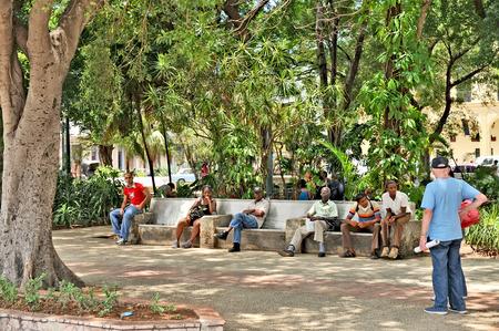 HAVANA, CUBA, MAY 6, 2009  People sitting in a park in Havana, Cuba, on May 7th, 2009