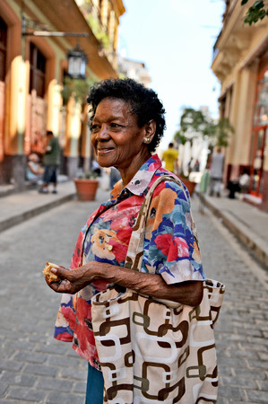 HAVANA, CUBA, OCTOBER 20, 2009  A middle aged Cuban woman standing on the street, posing, in Havana, Cuba, on October 20th, 2009