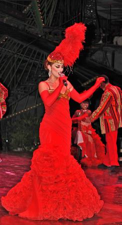 tropicana: HAVANA, CUBA, MAY 7, 2009  An astonishing singer in a long red dress performing in Tropicana in Havana, Cuba, on May 7, 2009