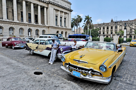 HAVANA, CUBA, MAY 11, 2009   Old American cars parked in front of El Capitolio, or National Capitol Building  in Havana, Cuba, on May 11th, 2009