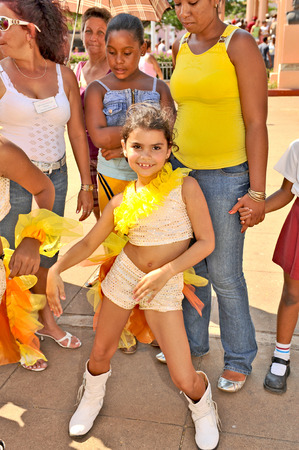 cuba girl: REMEIDOS, CUBA, OCTOBER 27, 2009  A beautiful young girl in the age of five smiling at the camera during a town festival, in Remeidos, Cuba, on October 27th, 2009