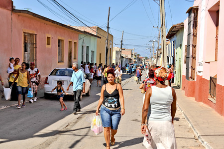 shop keeper: TRINIDAD, CUBA, OCTOBER 27, 2009  A shop keeper woman and her child inside a shop, in Trinidad, Cuba, on October 27th, 2009