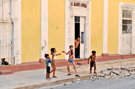 CIENFUEGOS, CUBA, OCTOBER 25, 2009  Children playing on the street, in Cienfuegos, Cuba, on October 25th, 2009