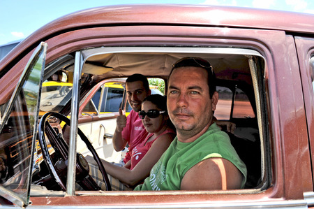 americal: TRINIDAD, CUBA, OCTOBER 27, 2009  PEople in an old car  in Trinidad, Cuba, on October 27th, 2009