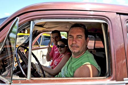 americal: TRINIDAD, CUBA, OCTOBER 27, 2009  PEople in an old car  in Trinidad, Cuba, on October 27th, 2009