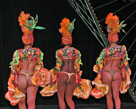 tropicana: HAVANA, CUBA, MAY 7, 2009  Three female dancers dancer performing in Tropicana in Havana, Cuba, on May 7, 2009  The dancers are showing their backs to the audience  Editorial