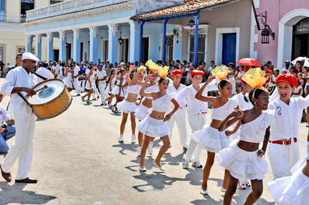 REMEIDOS, CUBA, MAY 7, 2009  Lots of young girls dancing in a procession during the celebration of San Juan de los Remeidos, the Holy John of Remeidos, in Remeidos, Cuba, on May 7th, 2009