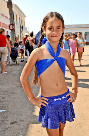 REMEIDOS, CUBA, MAY 7, 2009  A cute young girl of the age of five in a costume during the celebration of San Juan de los Remeidos, the Holy John of Remeidos, in Remeidos, Cuba, on May 7th, 2009