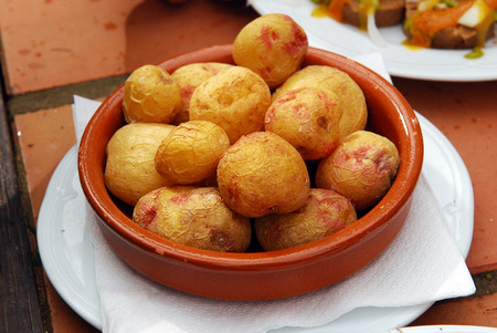 oven tray: Fuerteventura, Canary Islands  Fried whole potatoes on an oven tray