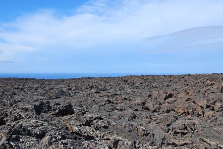 Lanzarote, Canary Islands, Spain  A big lava lake on a sunny day with a blue sky Stock Photo - 27196549