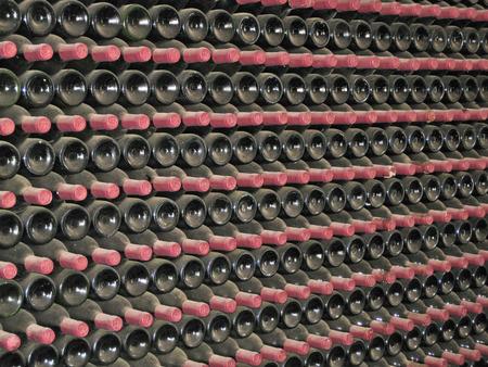 dozens: Lanzarote, Canary islands, Spain  A closeup of dozens of vine bottles in a vine cellar  Stock Photo