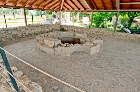 dug well: OHRID, MACEDONIA, MAY 18, 2011  A well in an archeological site around the newly built St  Clement�s Church in Ohrid, Macedonia, on May 18th, 2011