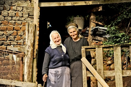 OHRID, MACEDONIA, MAY 17, 2011  Two old Macedonian ladies in the countryside of Ohrid, Macedonia, on May 17th, 2011