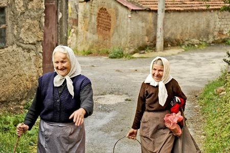 OHRID, MACEDONIA, MAY 17, 2011  Two old Macedonian ladies walking up the street in the countryside of Ohrid, Macedonia, on May 17th, 2011
