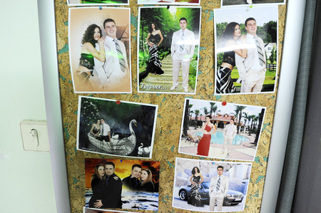 17th: OHRID, MACEDONIA, MAY 17, 2011  Printed photos representing a young couple in the wall of a a phtographer�s boutique in Ohrid, Macedonia, on May 17th, 2011