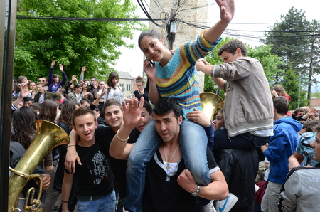 PRILEP, MACEDONIA, MAY 19, 2011  A procession of partying, shouting and laughing students on the street in Pirlep, Macedonia, on May 19th, 2011