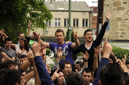 PRILEP, MACEDONIA, MAY 19, 2011  A procession of partying, shouting and laughing students on the street