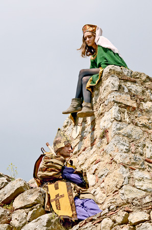 OHRID, MACEDONIA, MAY 18, 2011  People dressed in medieval clothes on the wall of the fortress of Tsar Samuil, in Ohrid, Macedonia, on May 18th, 2011