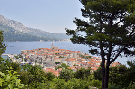 glooming: DUBROVNIK, CROATIA, MAY 23, 2011.  A view to the old town of Dubrovnik from the main coast road, with the sea in the horizon, in Dubrovnik, Croatia, on May 23rd, 2011