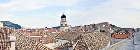 DUBROVNIK, CROATIA, MAY 23, 2011.  A panoramic wide view to the old town of Dubrovnik fand the wall surrounding the town, in Dubrovnik, Croatia, on May 23rd, 2011.