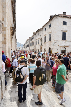 DUBROVNIK, CROATIA, MAY 22, 2011.  People walking on the main street of the old town of Dubrovnik. in Dubrovnik, Croatia, on May 22nd, 2011.