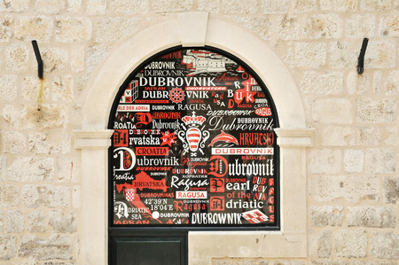 DUBROVNIK, CROATIA, MAY 22, 2011. A display window with old names of Dubrovnik in different fonts in the main street of the old town of Dubrovnik, in Dubrovnik, Croatia, on May 22nd, 2011.