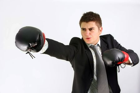 businessman over white boxing in suit with red gloves Stock Photo - 2345047