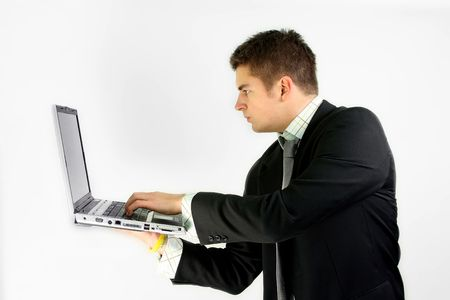 young businessman in suit is working on laptop Stock Photo - 2351931