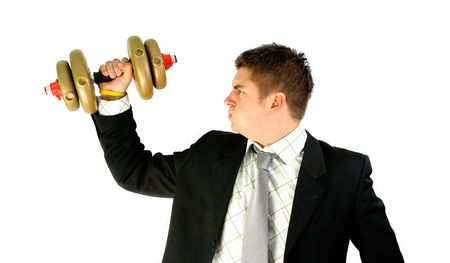 young businessman is trying with golden weight Stock Photo - 2351930