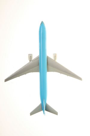 rise to the top: top view of blue plane over white background