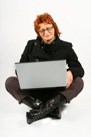 mature businesswoman is sitting with laptop on the floor Stock Photo - 2368149