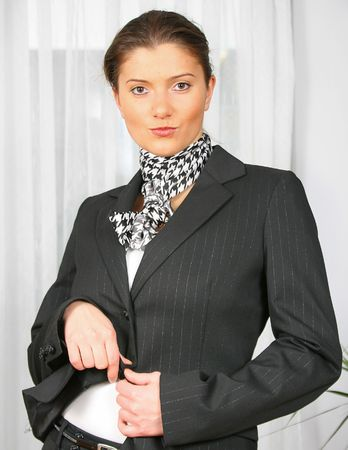 young woman is taking off her jacket Stock Photo - 2368151