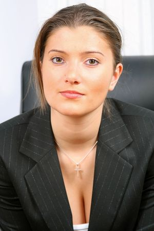 young businesswoman is sitting in front of the desk Stock Photo - 2368156