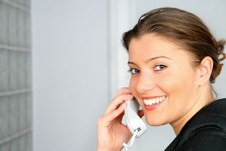 young businesswoman on phone in the office photo