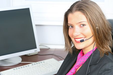 young woman on customer service with computer in background Stock Photo - 2368157