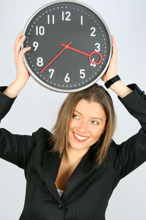 hamy and nice young businesswoman with clock Stock Photo - 2368153