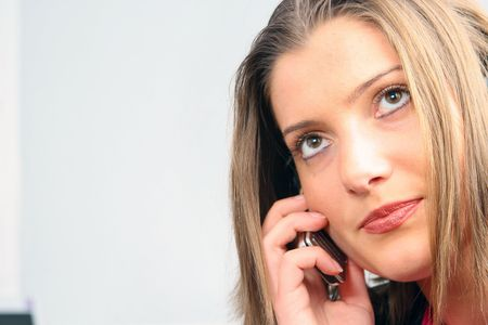 young businesswoman is talking on mobile phone photo