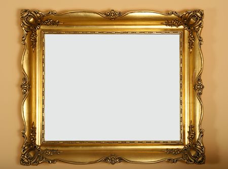 ornamentations: antique old gold frame on the wall