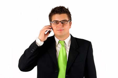Handsome young man in suit on the phone photo