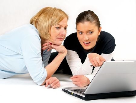 Mother and Daughter Using Laptop over white background Stock Photo - 2481207