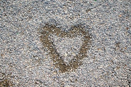 painted heart over small stones and rocks  Stock Photo - 2603967