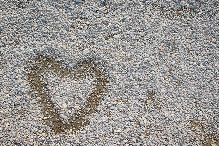 painted heart over small stones and rocks Stock Photo - 2603966