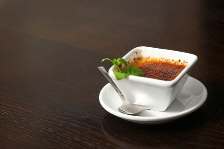 brulee: creme brulee on the table in smal white cup